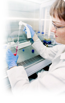 image of medical laboratory technologist extracting liquid using a pipette